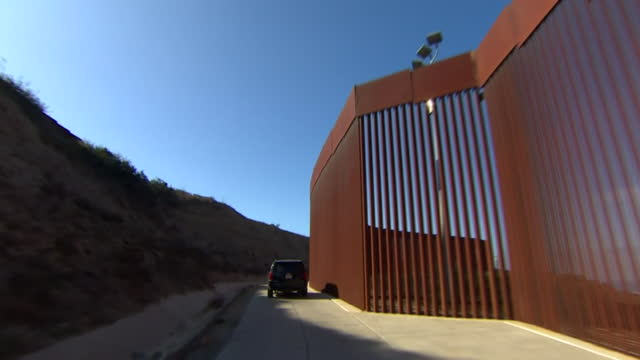 views from a car driving next to the usa-mexico border - international border barrier stock videos & royalty-free footage