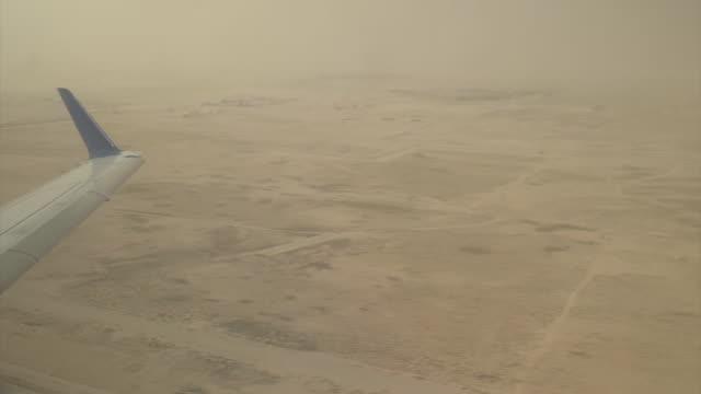 Views from plane of Saudi Arabia oil fields in desert