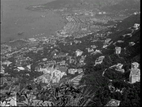 HONG KONG, 1950, views from Victoria Peak over harbour towards Kowloon; cannon on moutain side; view south over Ap Lei Chau.