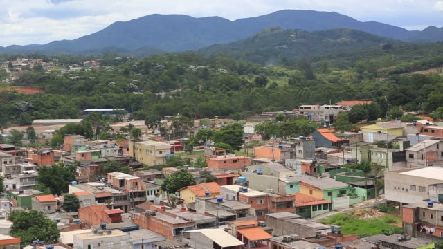 Views from water reservoirs standing in the rooftops of poor housings in Guarulhos outskirts of Sao Paulo Brazil Izilda Aparecida blames wealthy...