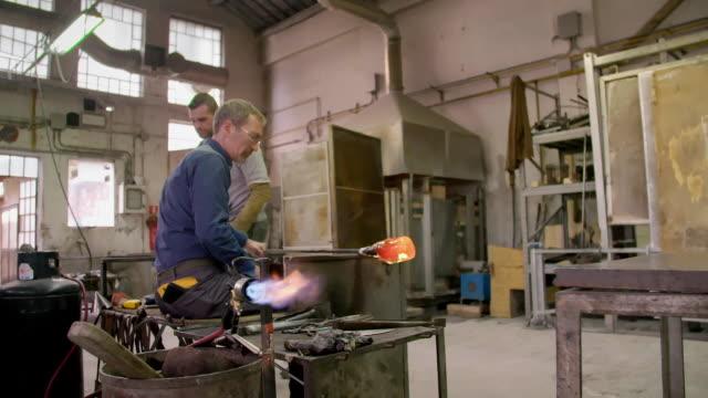 views inside a glassmaking workshop - rod shape stock videos & royalty-free footage