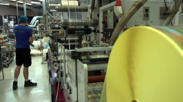views inside a label printing factory in londonderry - printing out stock videos & royalty-free footage