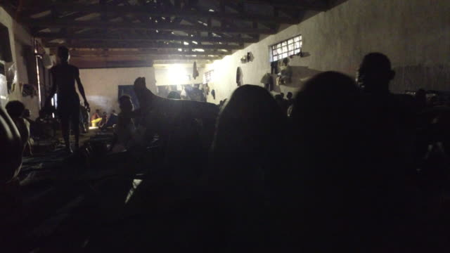 views inside a migrant detention centre in libya - libya stock videos and b-roll footage