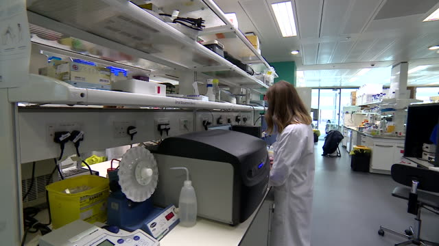 views inside a science laboratory - lab coat stock videos & royalty-free footage