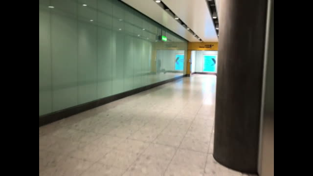 views inside a uk airport during coronavirus lockdown - warning sign stock videos & royalty-free footage