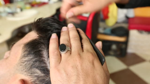 Views of a barber cutting hair