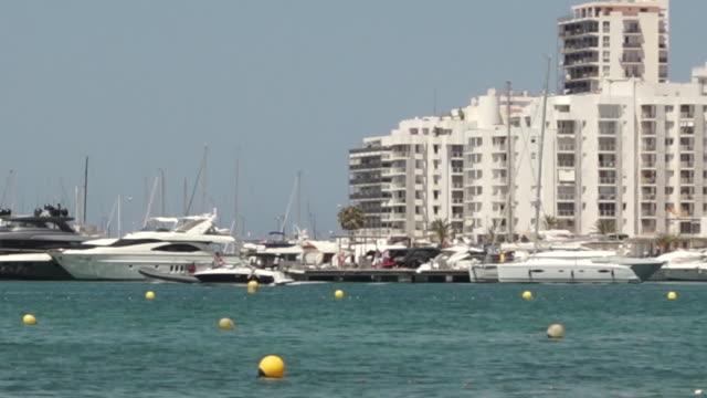 "views of a beach in ibiza - ""bbc news"" video stock e b–roll"