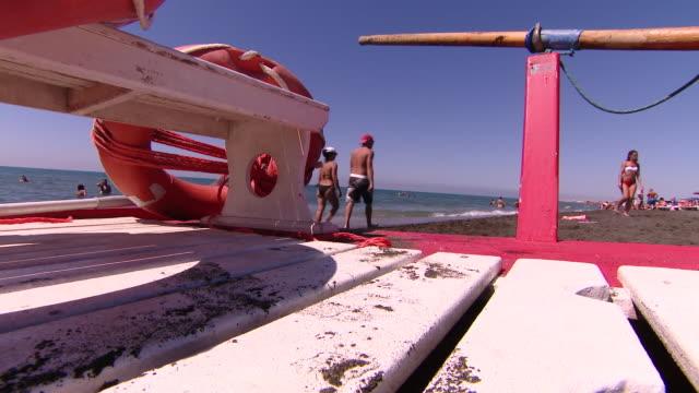 """views of a beach near rome - """"bbc news"""" video stock e b–roll"""