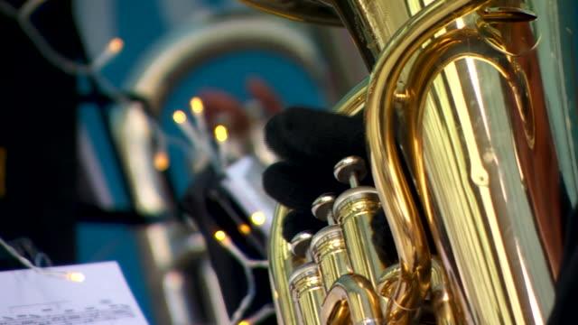 views of a brass band playing christmas songs - ブラスバンド点の映像素材/bロール