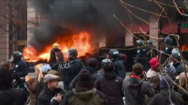 views of a burning vehicle on the streets of washington dc as antidonald trump supporters clash with riot police on inauguration day - amtseinführung stock-videos und b-roll-filmmaterial