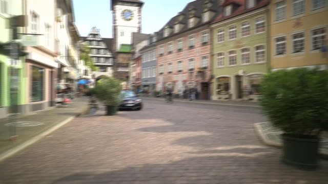 """views of a busy street in southern germany - """"bbc news"""" stock-videos und b-roll-filmmaterial"""
