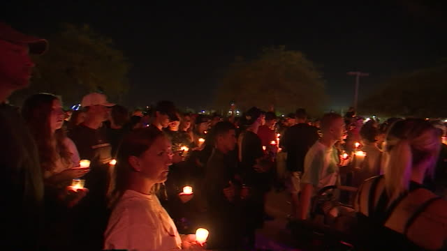 views of a candlelight vigil to remember victims of the las vegas mass shooting - candlelight stock videos & royalty-free footage