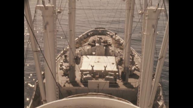 vidéos et rushes de views of a cargo ship moving through the water. - nostalgie
