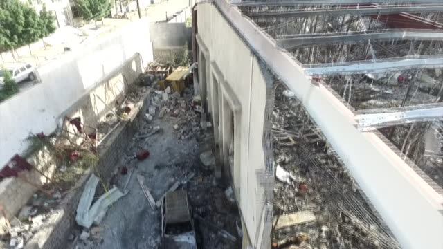 views of a community hall in sana'a yemen which was destroyed by a saudi arabian air strike - yemen stock videos and b-roll footage