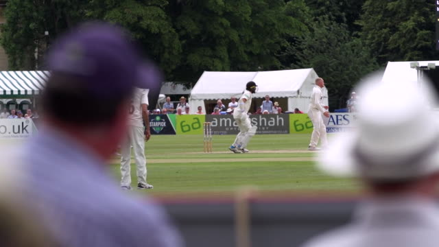 views of a cricket match in gloucestershire - cricket stock videos & royalty-free footage