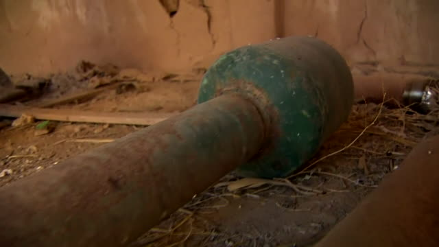 Views of a crude homemade chemical weapon used by Islamic State created with chlorine gas attached to an improvised mortar