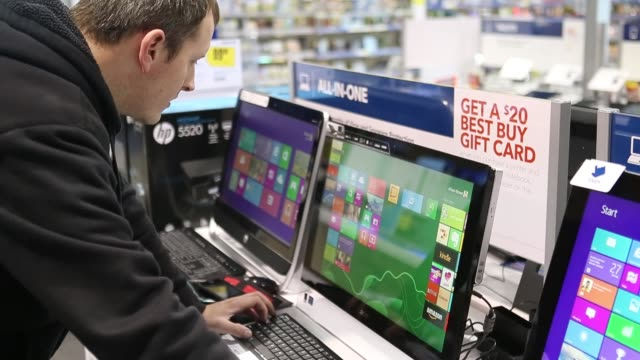stockvideo's en b-roll-footage met views of a customer testing out microsoft windows 8 operatin system on a computer on display customer testing out windows 8 at best buy on october 26... - orem utah