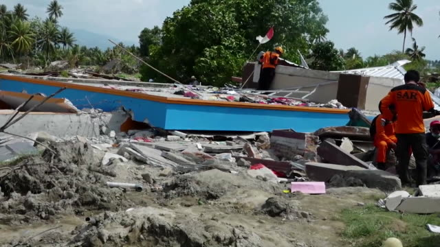 views of a destroyed christian study centre in palu, indonesia, after a devastating tsunami and earthquake hit the island of sulawesi - rubble stock videos & royalty-free footage