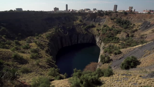 views of a diamond mine in south africa owned by arron banks - baufahrzeug stock-videos und b-roll-filmmaterial