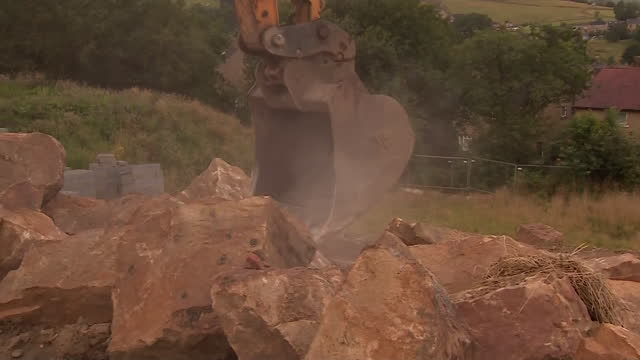 views of a digger breaking up rocks - construction vehicle stock videos & royalty-free footage