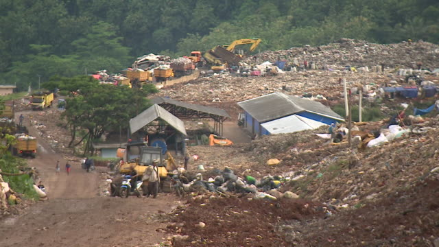 views of a landfill site in bandung indonesia - gratuity stock videos & royalty-free footage