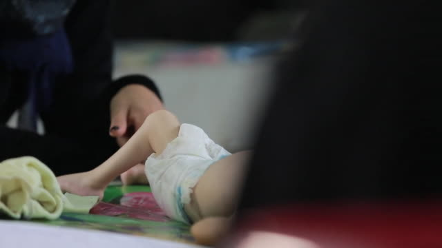 Views of a malnourished child and adults in Yemen