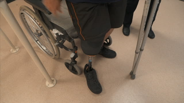 views of a man learning to walk on an artificial leg - orthopedic equipment stock videos & royalty-free footage