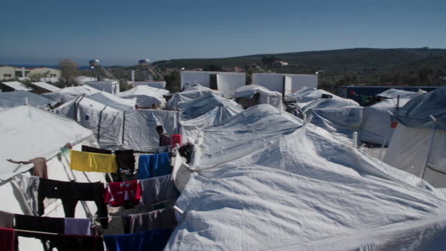 views of a migrant camp in lesbos greece - flüchtlingslager stock-videos und b-roll-filmmaterial