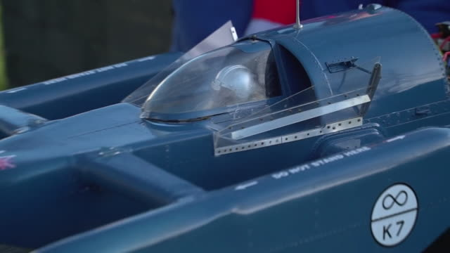 vídeos de stock, filmes e b-roll de views of a miniature replica of former world land and water speed record holder donald campbell's 'bluebird' on the 50th anniversary of his fatal... - carro foguete