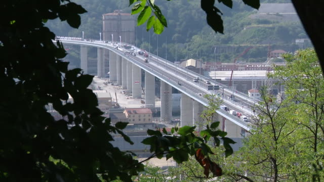 views of a newly built bridge in genoa made to replace the collapsed morandi bridge - bridge built structure stock videos & royalty-free footage