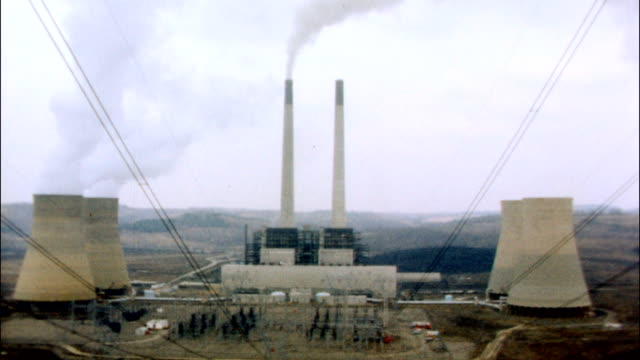 / views of a nuclear power plant, including cooling towers of the nuclear reactor. - nuclear reactor stock videos & royalty-free footage