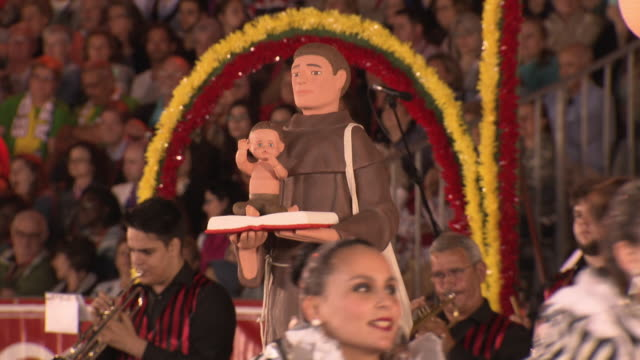 views of a of representation of st anthony holding jesus christ and a book amid performers at traditional feast of st anthony celebrations lisbon... - tinsel stock videos & royalty-free footage