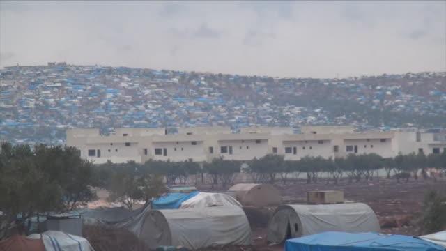 views of a refugee camp for aleppo evacuees in rebelheld idlib - シリア難民問題点の映像素材/bロール