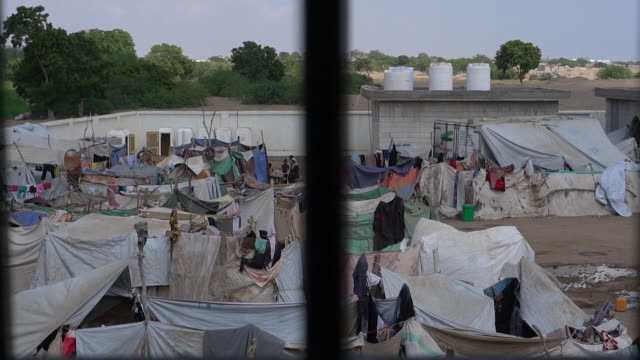 views of a refugee camp inside a school in aden, yemen - aden stock videos & royalty-free footage