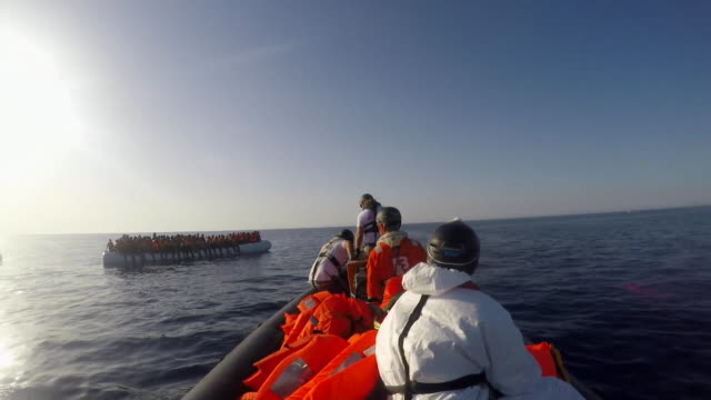 Views of a rescue boat saving stranded migrants in the Mediterranean Sea