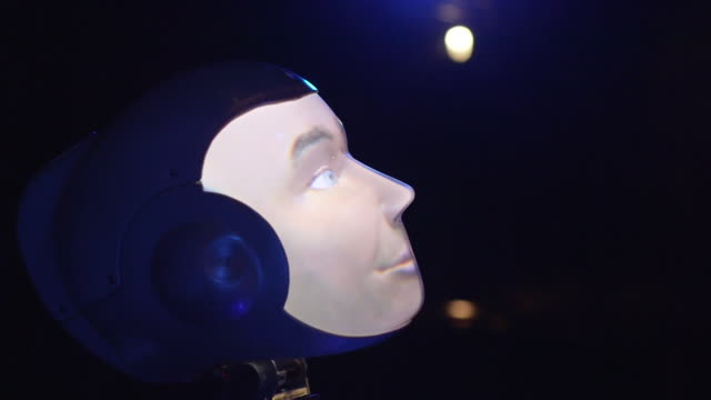 views of a robothespian robot actor 'looking' upwards and blinking on a theatre stage uk rushes taken from bbccom/culture absa734n - robot and human face stock videos & royalty-free footage