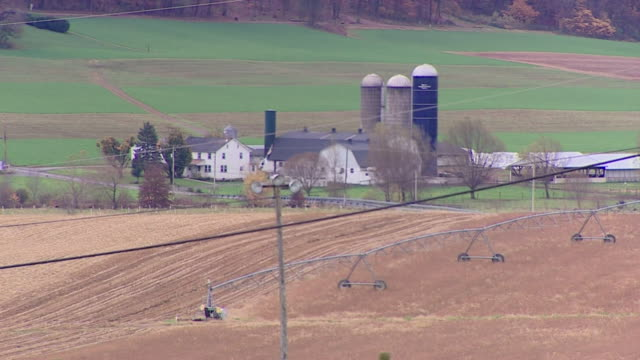 stockvideo's en b-roll-footage met views of a rural town in pennsylvania and a roadside sign saying 'the russians didn't elect trump...we did!' - pennsylvania