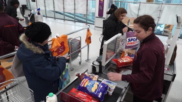 vídeos de stock e filmes b-roll de views of a sainsbury's supermarket checkout uk - vendas