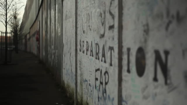 views of a separation wall between catholic and protestant communities in belfast - capital cities stock videos & royalty-free footage