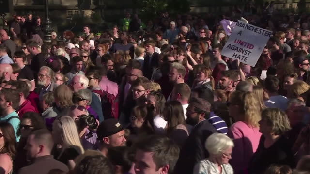 views of a sign saying 'manchester a city united against hate' at a vigil for victims of the manchester arena bombing - manchester england stock videos & royalty-free footage