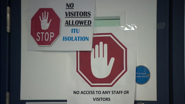 views of a specialist coronavirus isolation ward in a hospital - warning sign stock videos & royalty-free footage