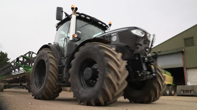 views of a tractor on a farm - b roll stock videos & royalty-free footage