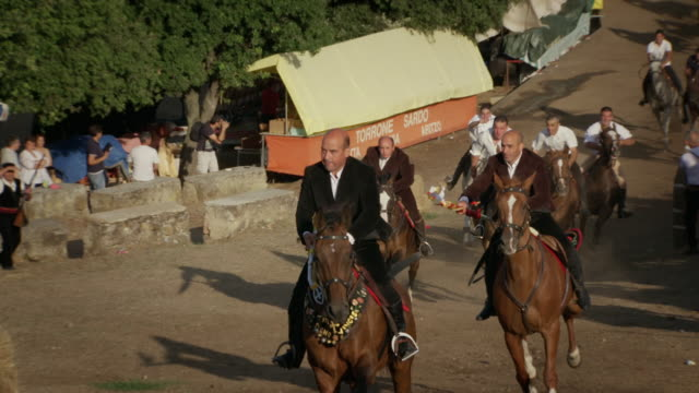 """views of a traditional horse race in sardinia - """"bbc universal"""" video stock e b–roll"""