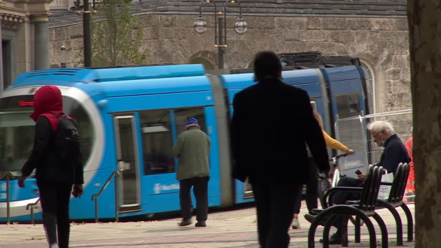 views of a tram moving through birmingham city centre - pedestrian stock videos & royalty-free footage