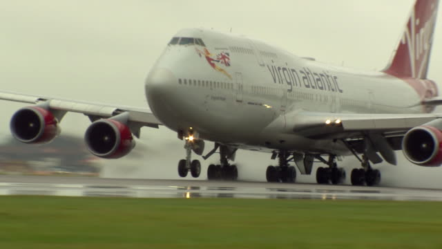 views of a virgin atlantic flight taking off - runway stock videos & royalty-free footage