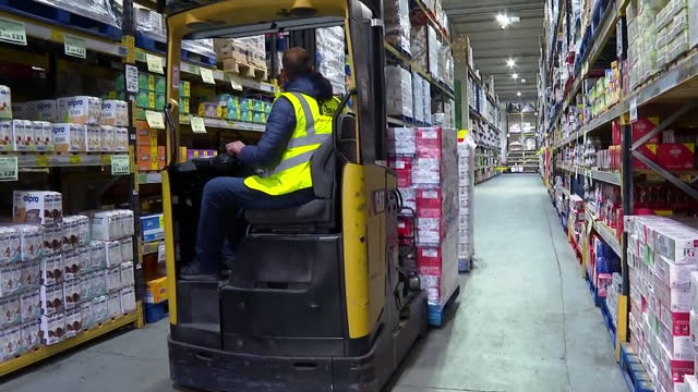 views of a warehouse worker removing pallets with a forklift - furniture stock videos & royalty-free footage