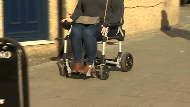 views of a woman using a mobility scooter - speed stock videos & royalty-free footage