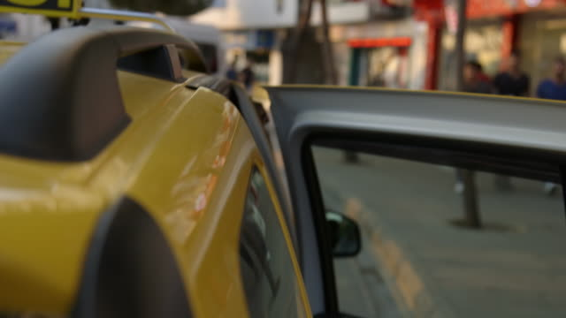 views of a yellow taxi in turkey - yellow taxi video stock e b–roll
