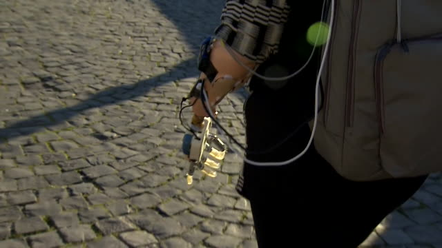 views of almerina mascarello who is testing new portable bionic prosthetic technology that allows her to control an artificial arm using her brain... - artificial limb stock videos & royalty-free footage