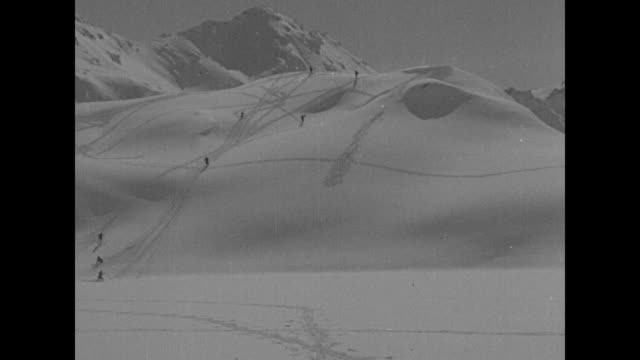 views of alpine skiers on white, pristine snowfields at great st. bernard pass in switzerland / note: exact day not known - alpine skiing stock videos & royalty-free footage